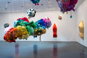 Mike Kelley. Deodorized Central Mass with Satellites. 1991/1999. Plush toys sewn over wood and wire frames with styrofoam packing material, nylon rope, pulleys, steel hardware and hanging plates, fiberglass, car paint, and disinfectant. Overall dimensions variable. (c) Estate of Mike Kelley.  Images courtesy of Perry Rubenstein Gallery, Los Angeles. Photography: Joshua White/JWPictures.com.